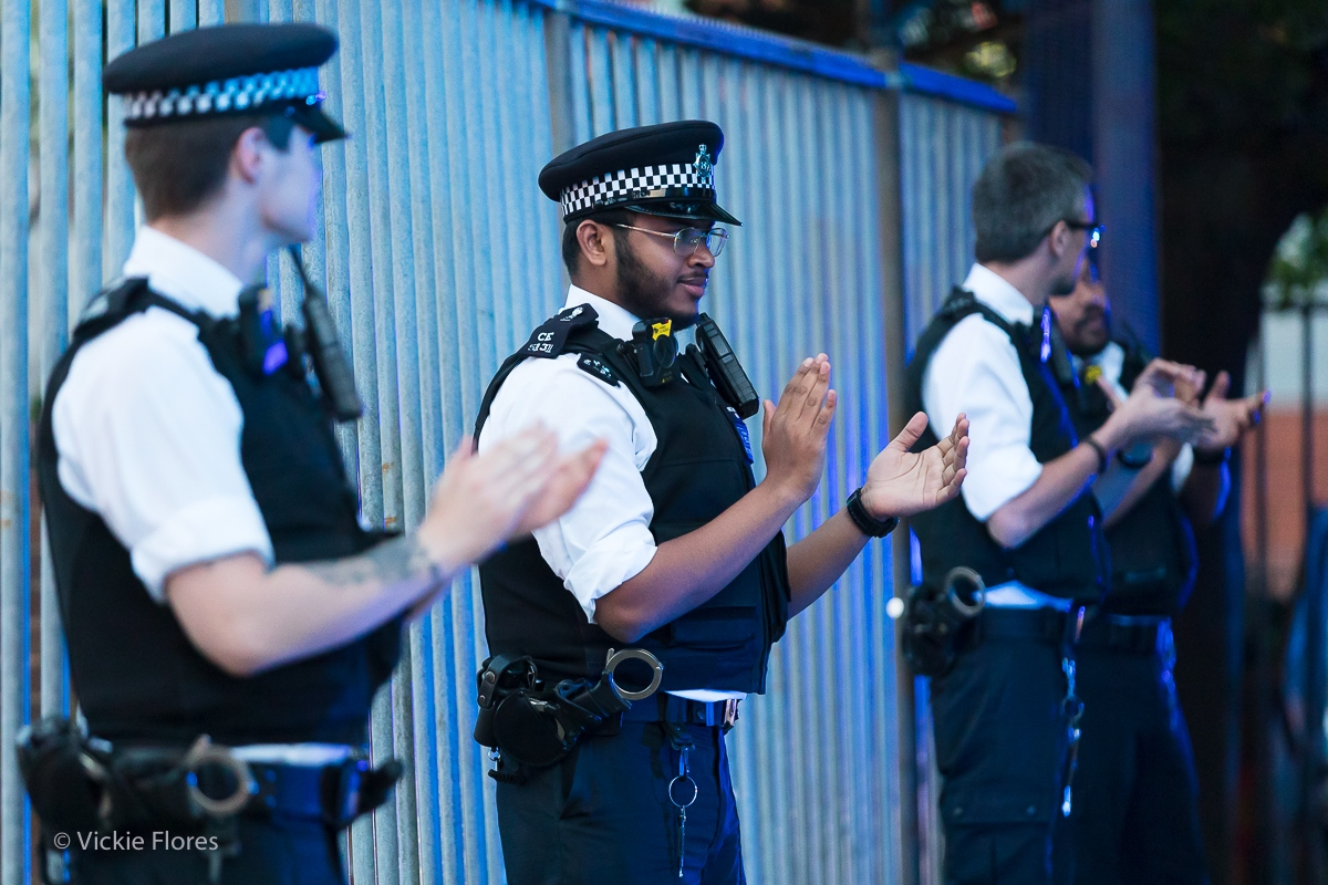 Police officers clap for carers outside the Royal London Hospital