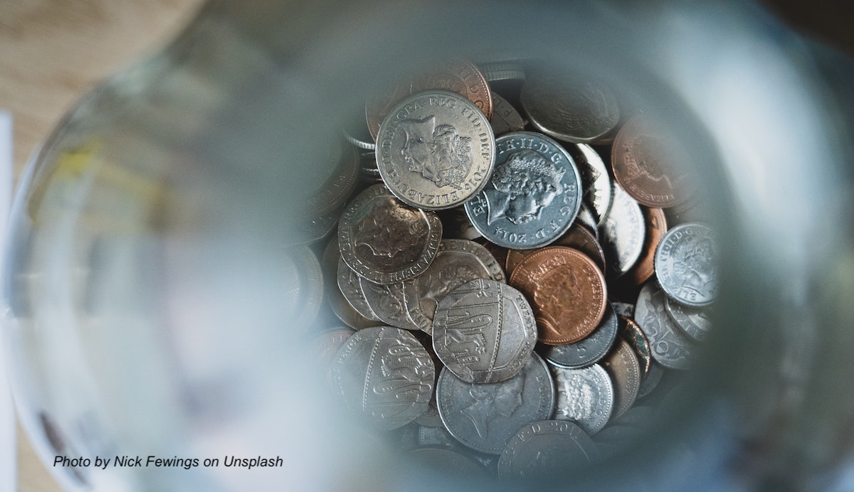 Photos of coins at the bottom of a glass jar