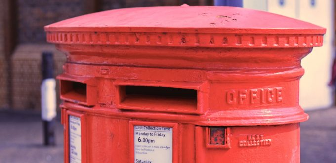 Photo of red old-fashioned GPO letterbox